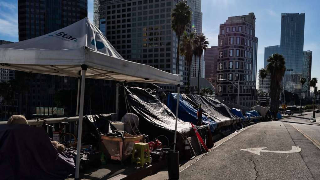 A homeless encampment is seen along a street in downtown Los Angeles next to the 110 freeway on . The Supreme Court will not review an appellate decision that makes it harder for cities to keep homeless people from sleeping on the streets
