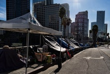 A homeless encampment is seen along a street in downtown Los Angeles next to the 110 freeway on . Th...