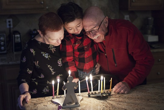 Lighting a menorah is just one Hanukkah tradition to do with your family.