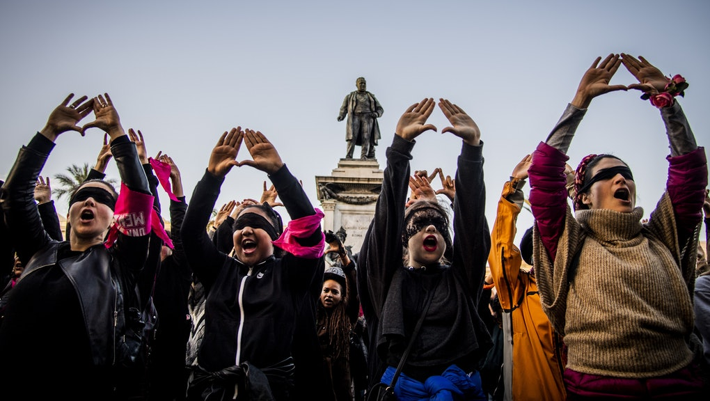 Female demonstrators during the flash mob 'Un violador en tu camino' in protest of violence against women, Rome