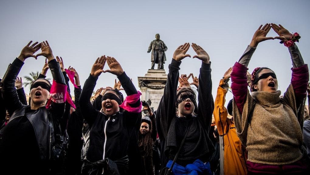 Female demonstrators during the flash mob 'Un violador en tu camino' in protest of violence against women, Rome
