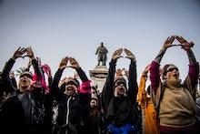 Female demonstrators during the flash mob 'Un violador en tu camino' in protest of violence against ...