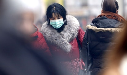 A woman walks with a protective mask  due to air pollution in Sarajevo, Bosnia and Herzegovina, 07 D...