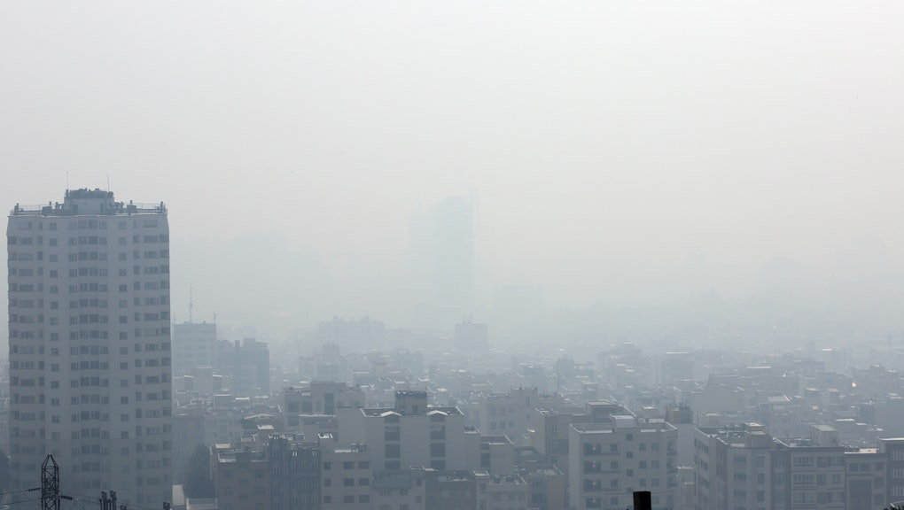 A general view shows smog obscures buildings in Tehran, Iran, 15 December 2019. Reports state Tehran's air pollution is reaching hazardous level prompting the government to declare one-day closure for schools in Tehran. Authorities have urged elderly and sick people as well as children to stay indoors.