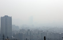 A general view shows smog obscures buildings in Tehran, Iran, 15 December 2019. Reports state Tehran...