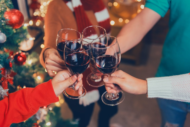 Christmas and New year party with Asian friends. Winter and end of year celebrating with drinking red wine.