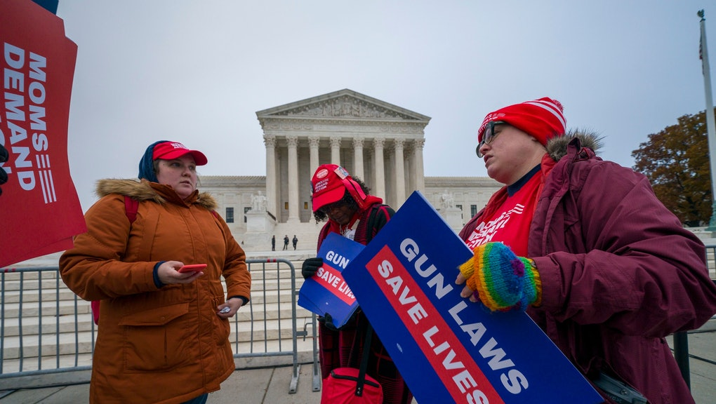 Activists gather outside the Supreme Court before the justices hear arguments in a case brought by gun owners in New York City, on Capitol Hill in Washington,. Advocates of gun control worry that the court's conservative majority could use the case to call into question restrictions across the country