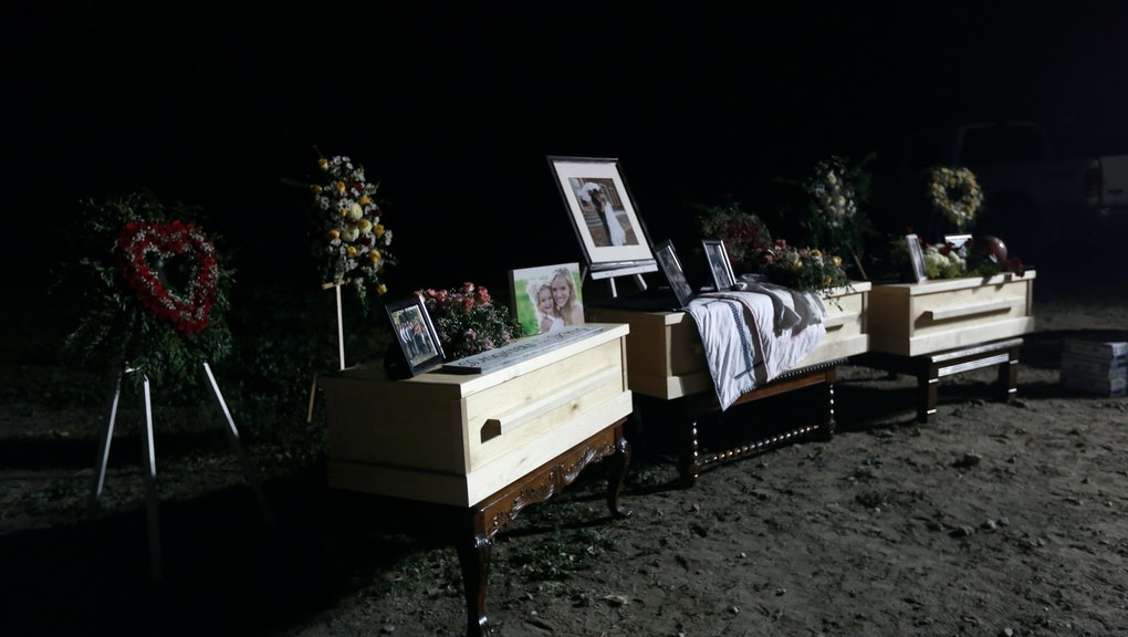 Family photos and flowers adorn the coffins that contain the remains of Rhonita Miller and her four children victims of a drug cartel ambush that left three women and six children dead, during their wake in La Mora, Mexico, . As Mexican soldiers stood guard earlier in the day, Dawna Ray Langford and her two sons were laid to rest together, just as they died together Monday when attackers fired a hail of bullets at their SUV