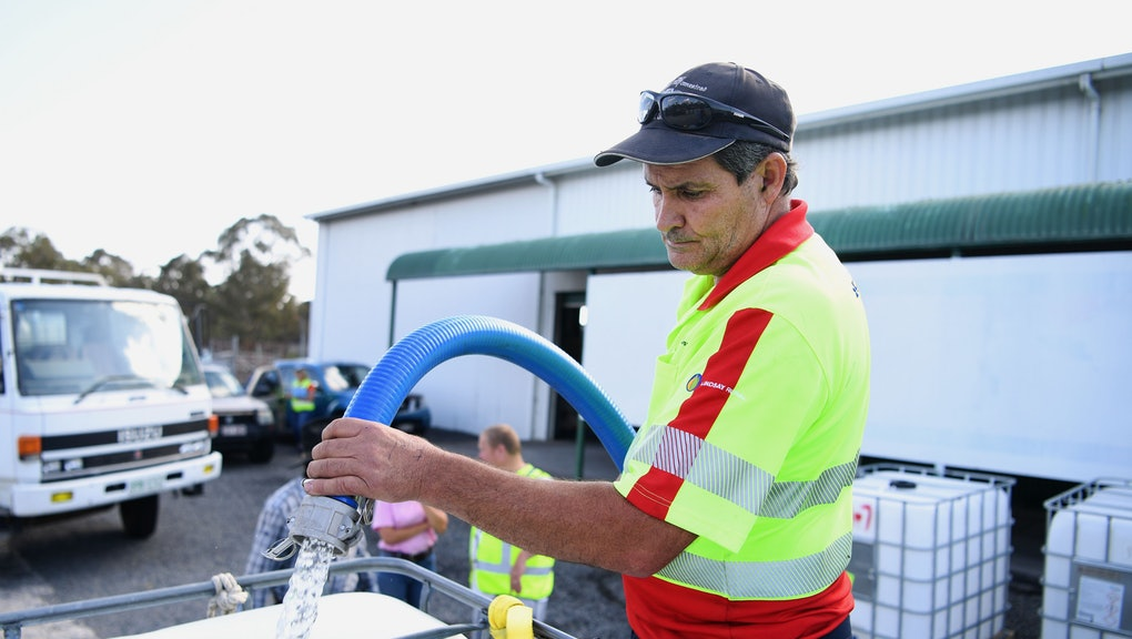 Russell Wantling, founder of Australian charity group Granite Belt Water Relief, fills up a water tank in Stanthorpe, Queensland, Australia, 16 October 2019 (issued 29 October 2019). The town of Stanthorpe has been struggling with severe drought and consequential bushfires since September 2019. With the dam's water level down to 25 percent, the town faces an imminent water shortage. Queensland Premier Annastacia Palaszczuk announced in September 2019 a plan to truck in 1.6 million liters of water from a nearby dam to the Storm King Dam, as Stanthorpe is predicted to run out of water by Christmas.