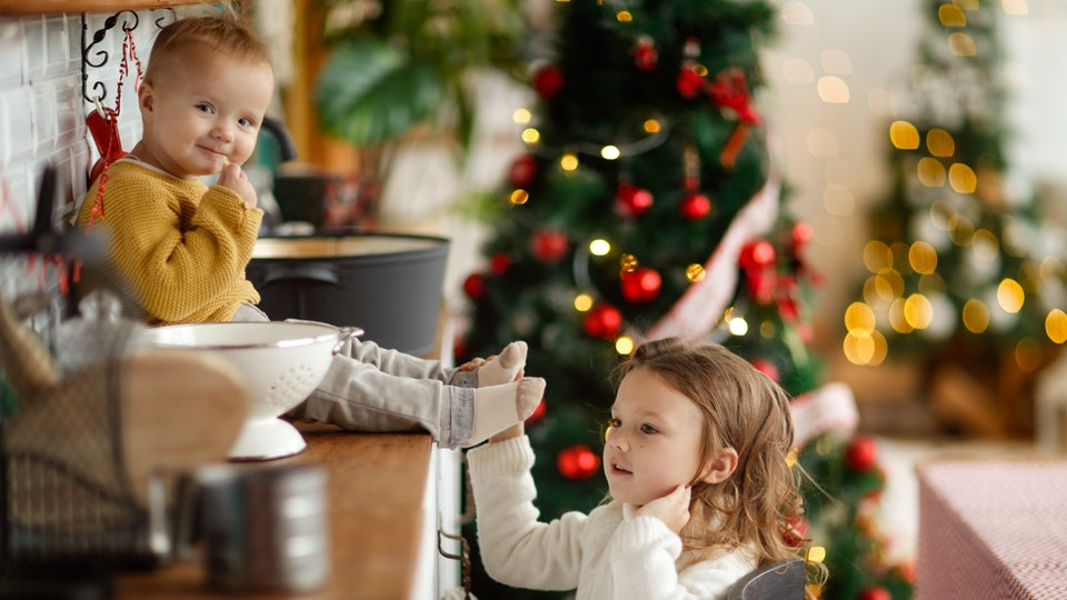 Buying for a new baby at Christmas can mean hand-me-downs as presents.