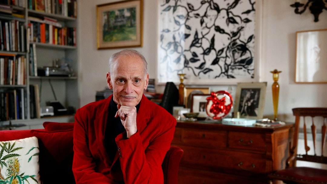"Filmmaker John Waters poses for a photograph during an interview with The Associated Press at his home in Baltimore. ""I like it (Christmas) because it's excessive, it's crazy, you can't ignore it, and it makes people nuts,"" he said. Baltimore's homegrown pop-cultural icon dubbed the ""Pope of Trash"" has been touring U.S. theaters in recent weeks to spread his particular brand of holiday cheer with a long-running show called ""A John Waters Christmas"