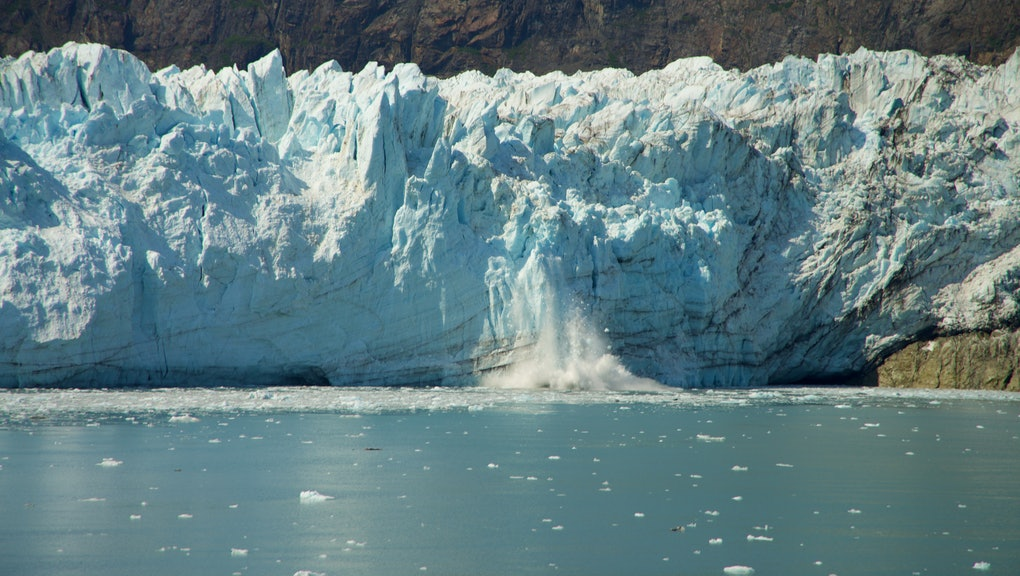 Chunk of Ice falling off Glacier, in Glacier Bay National Park and Preserve