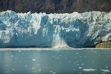 Chunk of Ice falling off Glacier, in Glacier Bay National Park and Preserve
