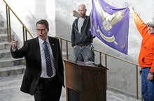 Rep. Matt Shea, left, R-Spokane Valley, gestures as he gives a speech in front of the liberty state ...