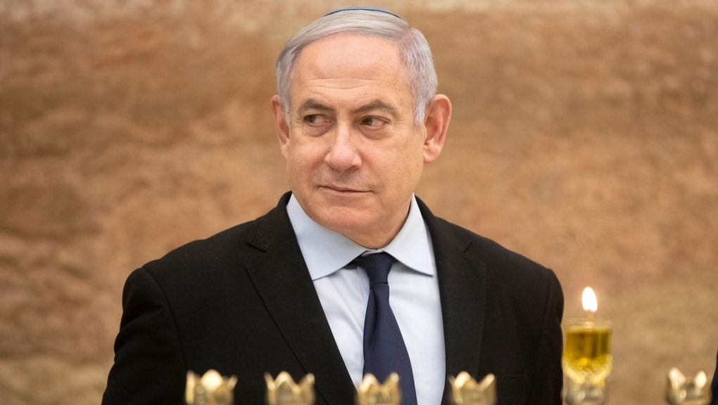 Israeli Prime Minister Benjamin Netanyahu looks on after lighting a Hanukkah candle at the Western Wall, the holiest site where Jews can pray in Jerusalem's old city