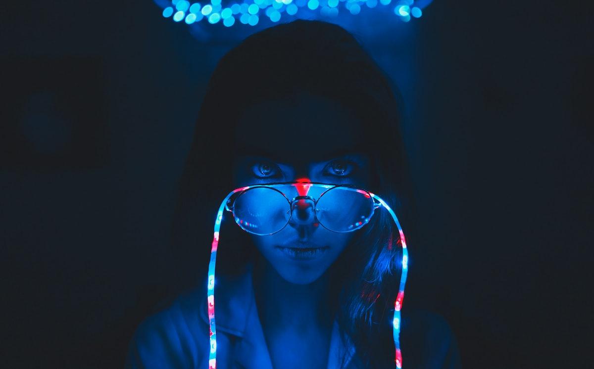 On the girl's glasses garland.  Photo in dark blue