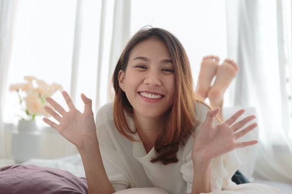 Portrait of beautiful smiling woman in bed at home