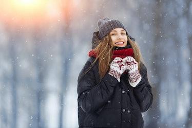 Winter young woman portrait. Beauty Joyful Model Girl laughing and having fun in winter park. Beauti...