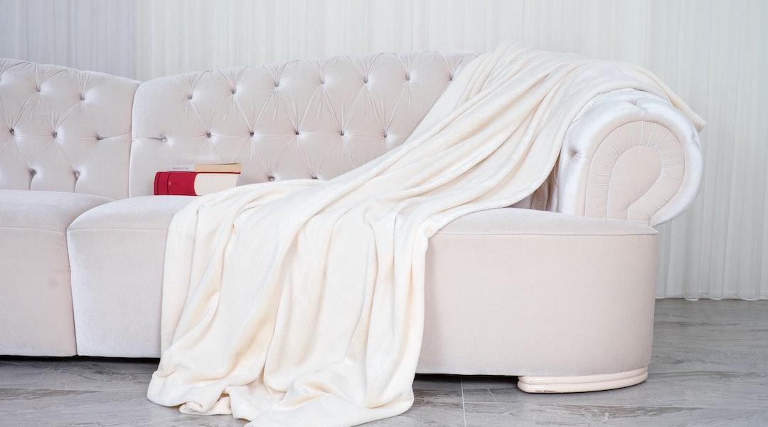 wellsoft throw blanket on the white sofa