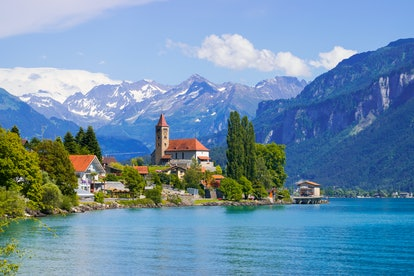 Panoramic view to the Brienz town on lake Brienz by Interlaken, Switzerland. Old fishing town with b...