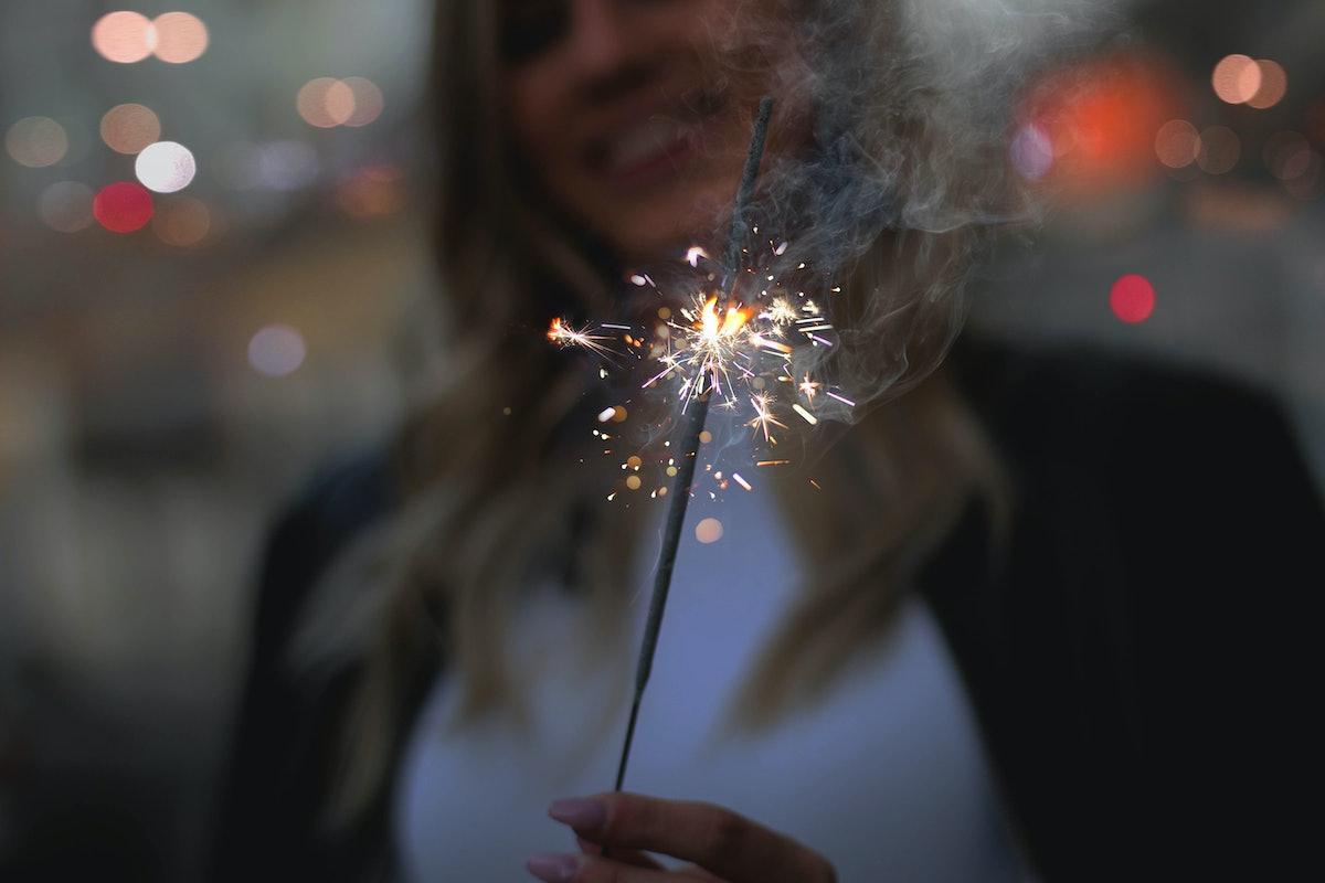 Girl with sparkler .Sparkler smoke Christmas time,Christmas concept