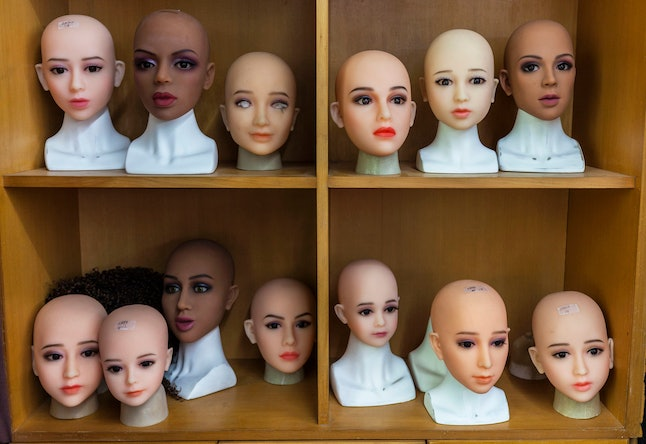 Heads of the 'smart' sex dolls on display in dolls factory in Dongguan, Guandong Province, China, 24 April 2018. Shenzhen Atall Intelligent Robot Technology is one of China's leading companies for robots equipped with AI (artificial intelligence). Among the company?s various AI robot products, its best-selling is an AI sex robot named Emma. The multi-functional machine is linked to the internet and Android operating system and features high stimulation capabilities. Sex robots have soft and elastic skin made of modified thermoplastic elastomers (TPE) material, with less oil content and no smell. Its temperature adjustment is set to 37 C to resemble a human's. Safety issues are managed with anti-electric shock, anti-fire and anti-explosion measures. And the addition of body sensors help make sex robots feel more like a human. But a semblance of authenticity doesn't come cheap, and Emma's online retail price is about 20,000 RMB ($3,136) with most customers being men aged 40-50.  Most clients are from Europe and the United States. There is also high interest for sex robots in the Middle East but importing them and sex toys into these countries is prohibited. It's a similar situation with Brazil, Chile and Argentina along with Russia and Philippines - where customs clearance for the robots is problematic. Male sex robots are also on the market but the sales volume is nine times lower compared to the female models. However, the market is constantly changing, and in recent years demand for male sex robots has been increasing, such as in Korea and Thailand. Shenzhen Atall also sells child-size AI sex robots, both male and female and the biggest market for them is the US and Canada.