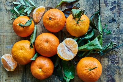 fresh clementines on wooden background