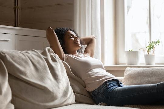 woman lying on sofa at home