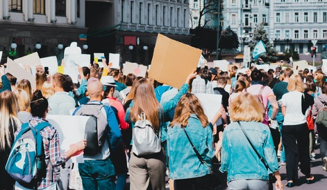 Young people marching on the street protest. Take a part in a march. Rally. Movement. Protest in the city