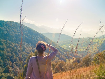 Woman looking far away into nature
