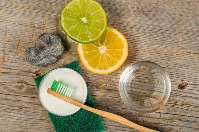 Baking soda, water, lemon, sponge, toothbrush and steel wool