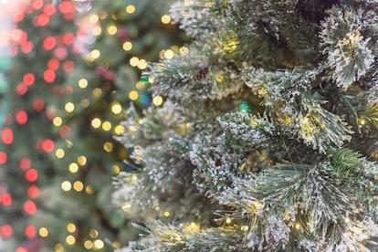 Beautiful white artificial Christmas tree with microdot and multi-lights pre-lit. Xmas decoration su...