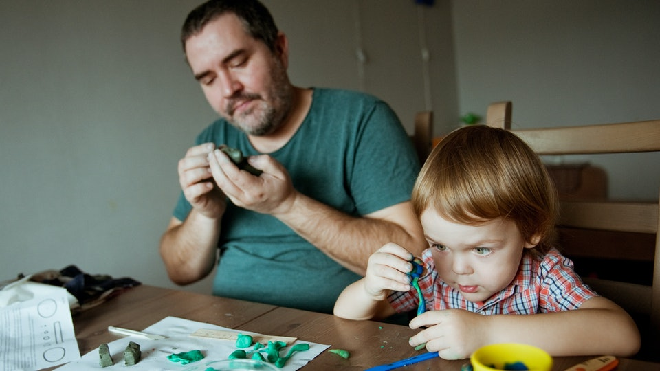 Dad and little boy playing with Play-Doh