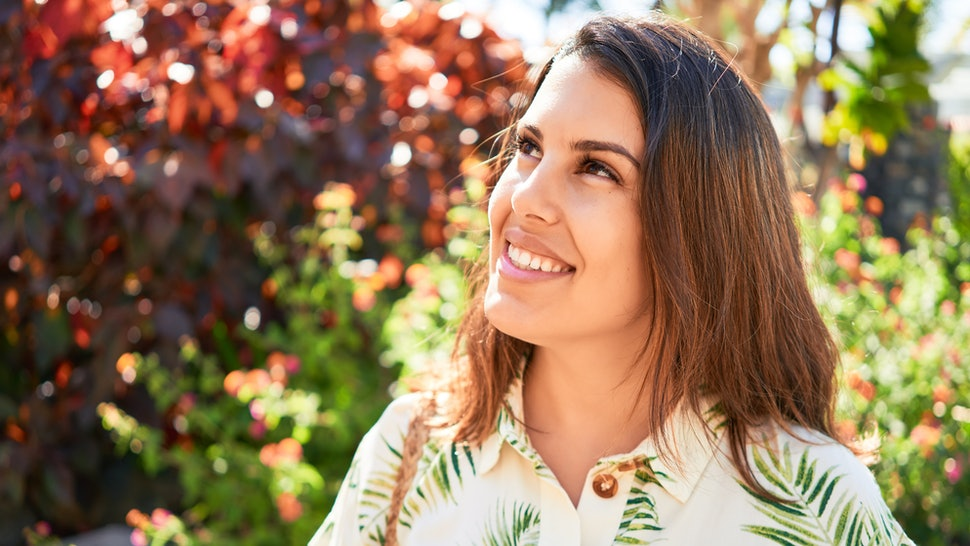 Young beautiful woman smiling happy enjoying sunny day of summer at hotel resort on holidays