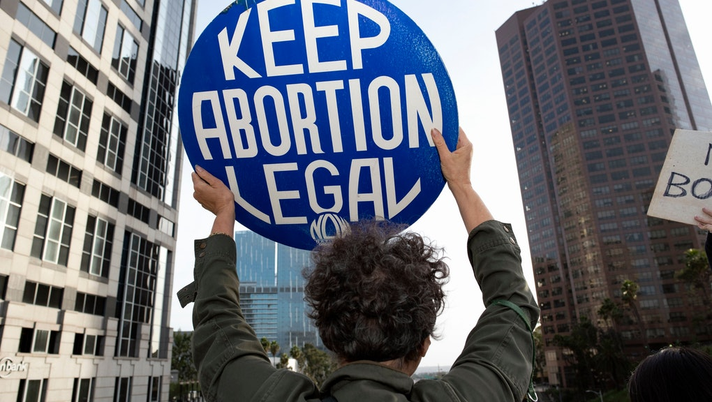An activist seen holding a placard that says Keep Abortion Legal during the protest.