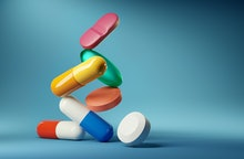 Medical balancing act. A group of medicine pills and antibiotics balacning on top of each other. 3D ...