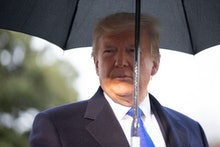 United States President Donald Trump speaks to members of the media on the South Lawn before he depa...