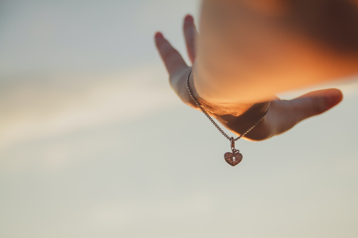 hand with bracelet raised to the sky