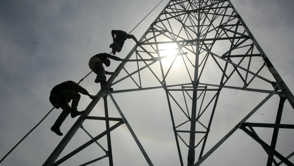 Workers Climb to Install a 60-meters Telecommunication Tower in Banda Aceh Indonesia 27 May 2014 the Increasing Number of Users of Mobile Devices in Indonesia Requires the Telecommunications Service Providers to Improve Their Infrastructure Such As the Additional Installation of Cell Towers in Densely Populated Areas Indonesia is One of the Largest Mobile Phone Users in Asia Indonesia Banda Aceh
