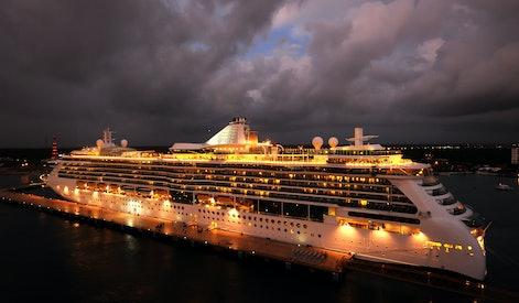 Ocean liner brightly lit at night
