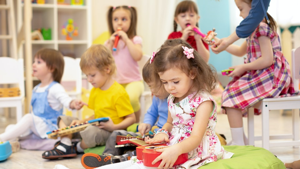 kids playing with musical instruments in a classroom