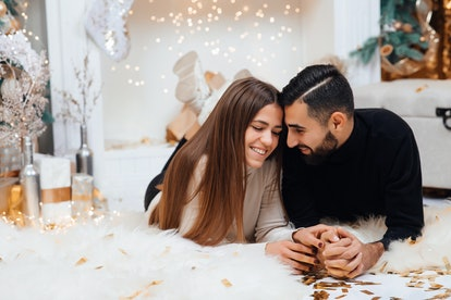 Adding some romance. Holiday romance of bearded man and sexy woman. Couple in love relaxing in the studio. Feeling romance. Love and romance. Christmas and New Year concept.