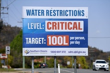 A billboard indicates critical water levels near Stanthorpe, Queensland, Australia, 16 October 2019 ...