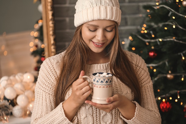 Beautiful woman drinking hot chocolate at home