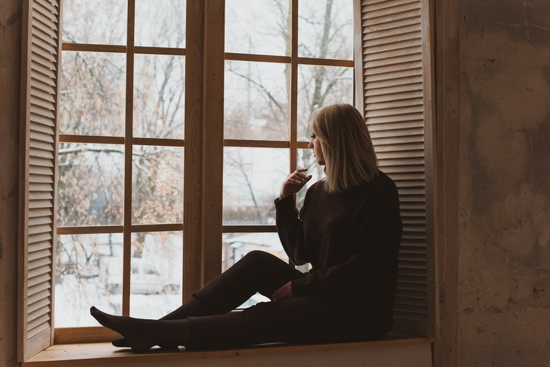 Seasonal depression, autumn - winter time, woman in sadness or thinking about something, concept of loneliness