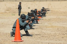 Afghan policemen attend a training session in Kandahar, Afghanistan, 21 October 2019. According to t...