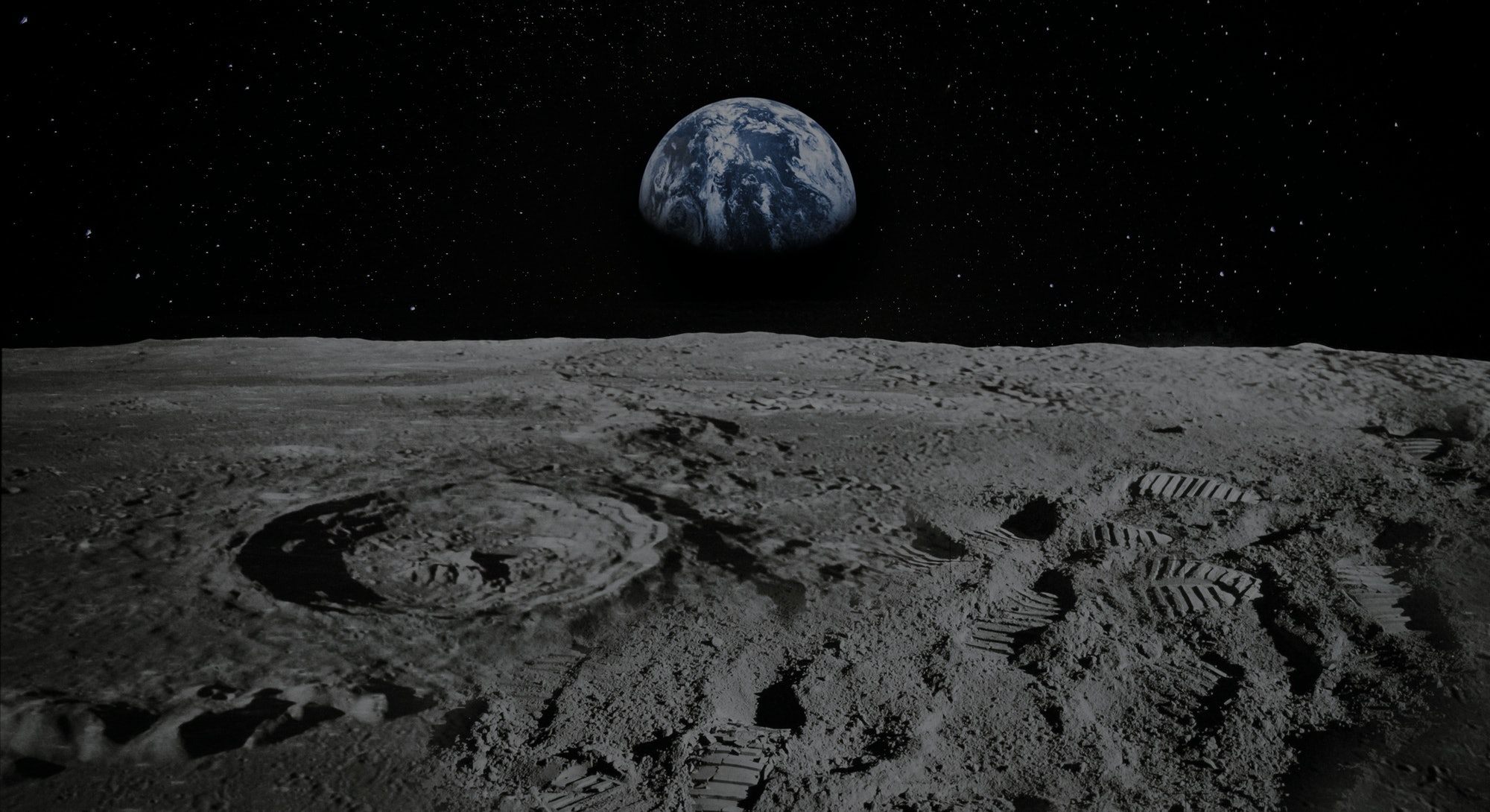 View of Moon limb with Earth rising on the horizon. Footprints as an evidence of people being there or great forgery. Collage. Elements of this image furnished by NASA.
