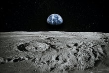 View of Moon limb with Earth rising on the horizon. Footprints as an evidence of people being there ...