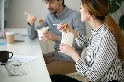 Office people eating chinese noodles holding boxes at lunch time, young woman and man employees enjoy japanese thai meal, colleagues tasting asian food at workplace, takeaway delivery service concept