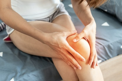 Young woman suffering from knee pain, Health care concept
